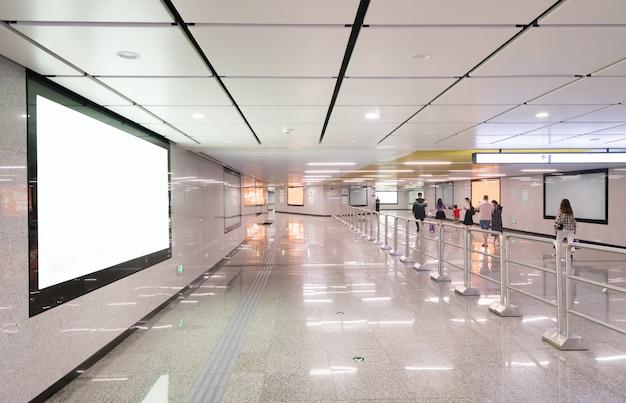 Light box advertising at subway station passageway