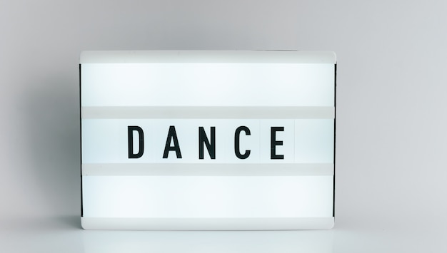 Light box with the headline dance with copyspace, over white background