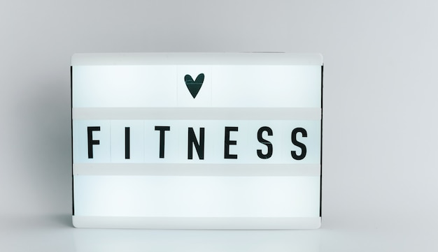 Light box with the headline fitness with copyspace, over white background