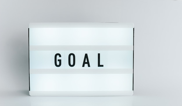 Light box with the headline goal with copyspace, over white background