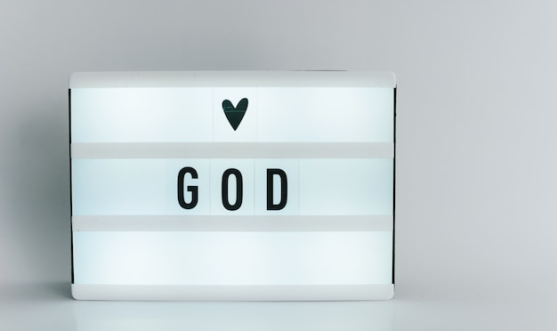 Light box with the headline god with copyspace, over white background