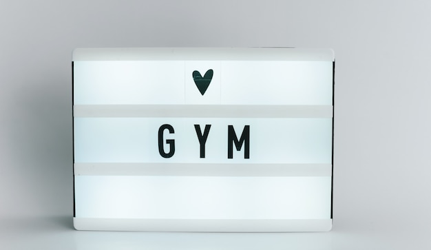 Light box with the headline gym with copyspace, over white background