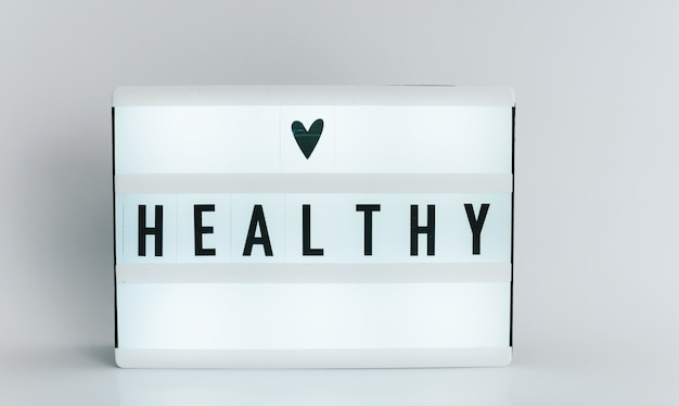 Light box with the headline healthy  with copyspace, over white background