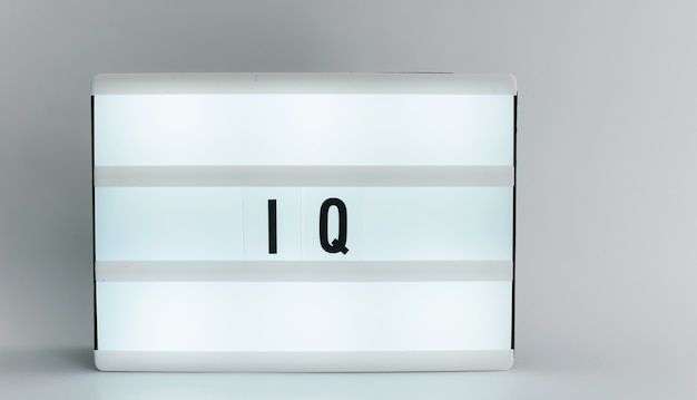 Light box with the headline iq with copyspace, over white background