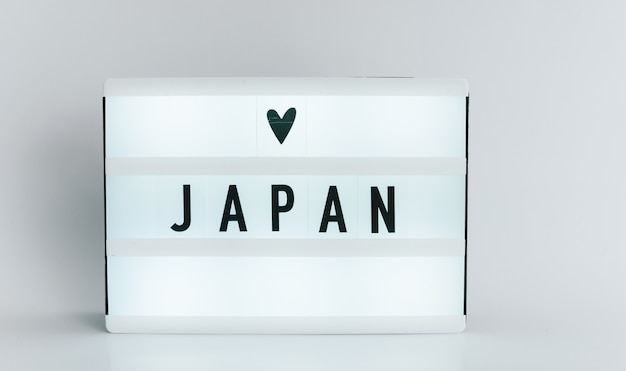 Light box with the headline japan with copyspace, over white background