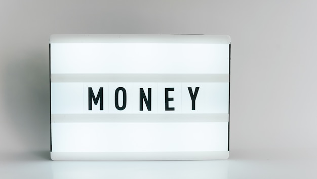 Light box with the headline money with copyspace, over white background