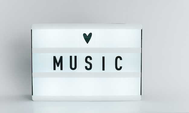 Light box with the headline music with copyspace, over white background