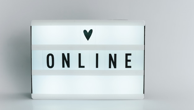 Light box with the headline online with copyspace, over white background