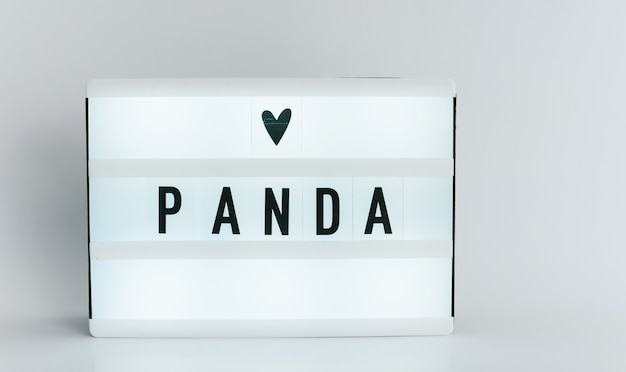 Light box with the headline panda with copyspace, over white background