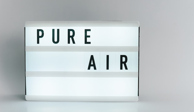 Light box with the headline pure air with copyspace, over white background
