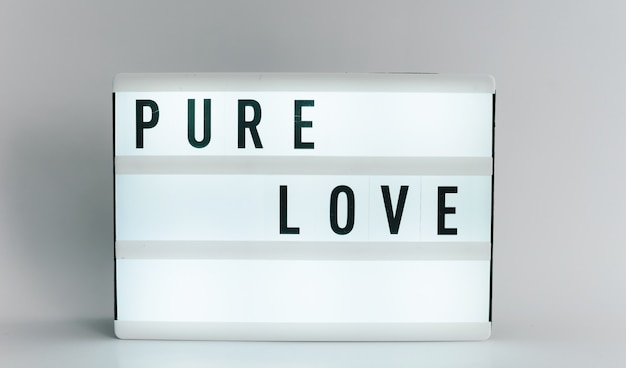 Light box with the headline pure love with copyspace, over white background