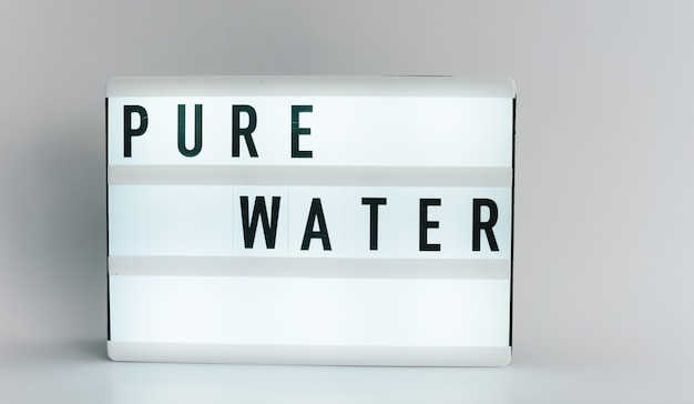 Light box with the headline pure water with copyspace, over white background