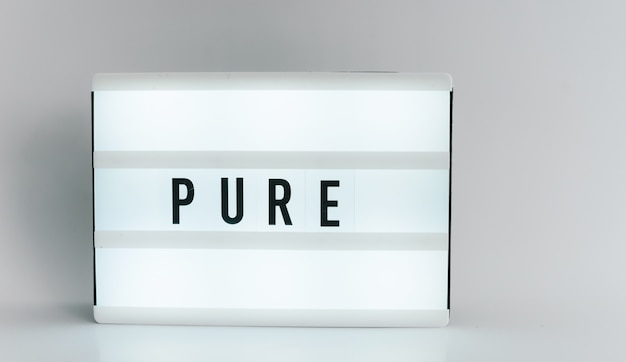 Light box with the headline pure with copyspace, over white background