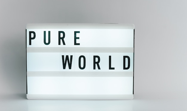 Light box with the headline pure world  with copyspace, over white background