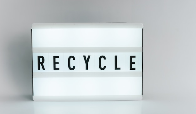 Light box with the headline recycle with copyspace, over white background