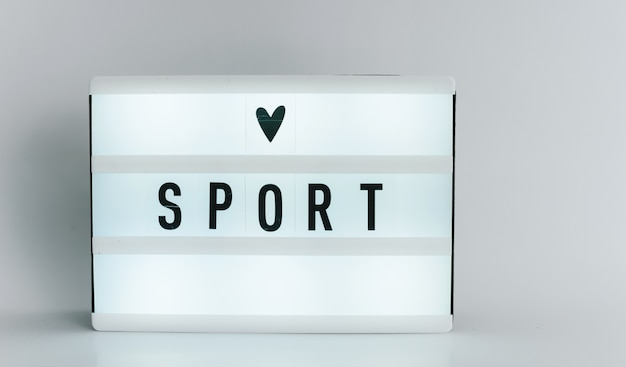 Light box with the headline sport with copyspace, over white background