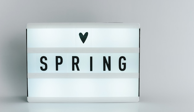 Light box with the headline spring with copyspace, over white background