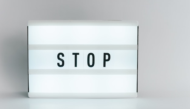 Light box with the headline stop with copyspace, over white background
