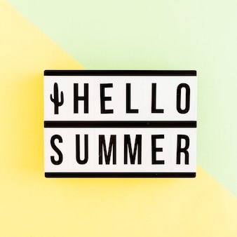 Light box with summer text on colored background