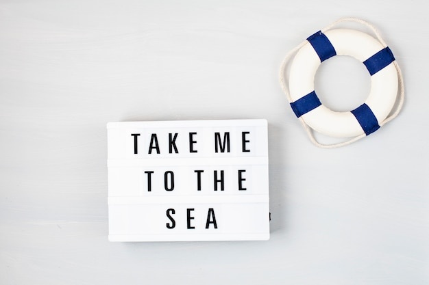 Light box with text take me to the sea