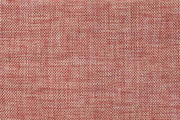 Light brown background of dense woven bagging fabric, closeup. structure of the textile macro.