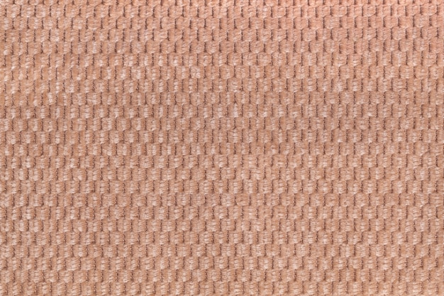 Light brown background from soft fleecy fabric closeup. texture of textile macro