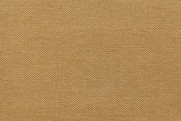 Light brown background from a textile material with wicker pattern