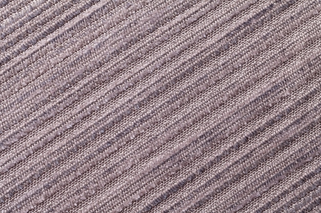 Light brown background of a knitted textile material