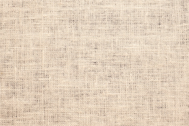Light brown canvas fabric texture background.
