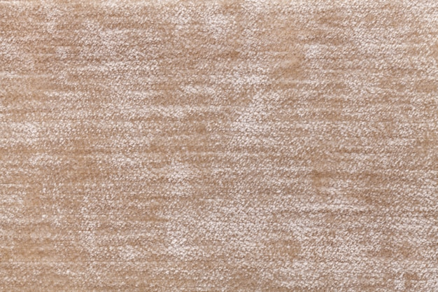 Light brown fluffy background of soft, fleecy cloth. texture of textile closeup.