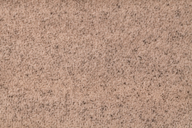 Light brown fluffy background of soft, fleecy cloth