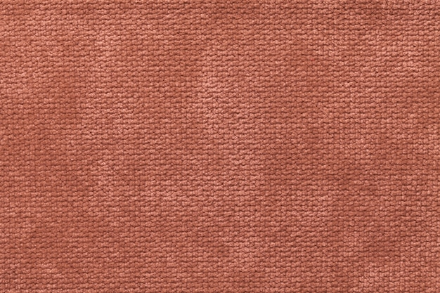 Light brown fluffy of soft, fleecy cloth. texture of light nappy textile, closeup.