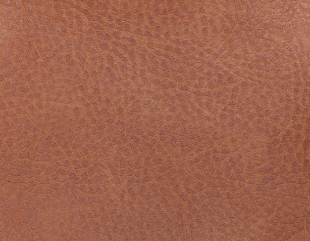 Light brown leather background from a textile material. fabric with natural texture.