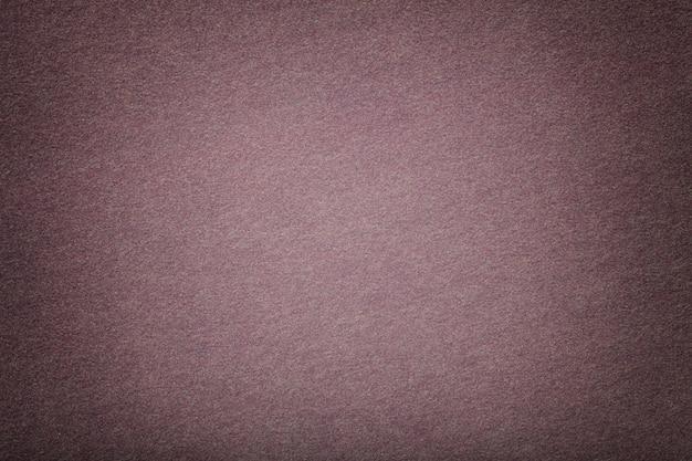 Light brown matt suede fabric closeup. velvet texture of felt.