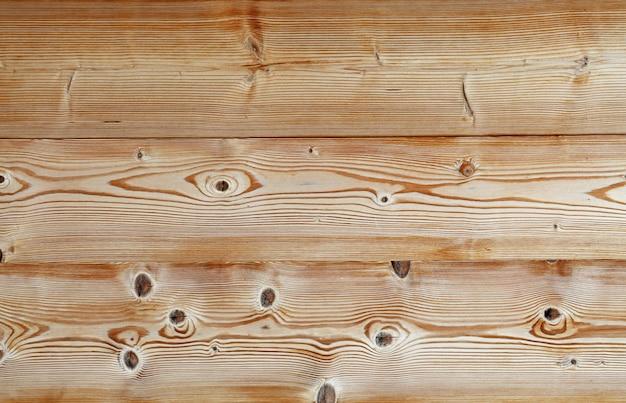 ライトブラウンの古いヴィンテージの木製の板の背景