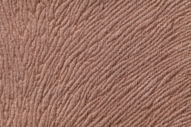 Light brown soft textile material, fabric with natural texture.