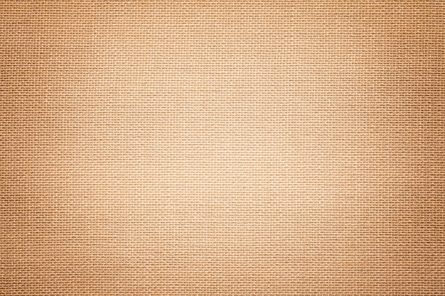 Light brown a textile material with wicker pattern, closeup.