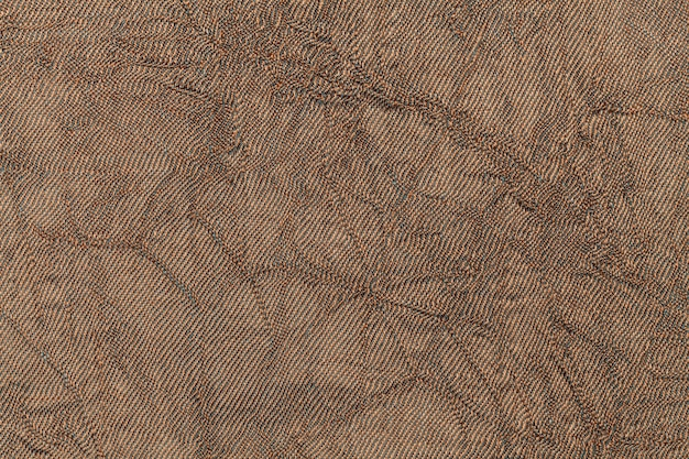 Light brown wavy background from textile material