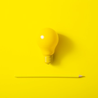 Light bulb and sharp pencil on yellow background