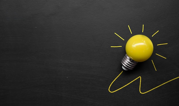 Light bulb on blackboard background