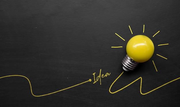Light bulb on blackboard background