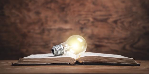 Light bulb on the book. knowledge, creative, wisdom