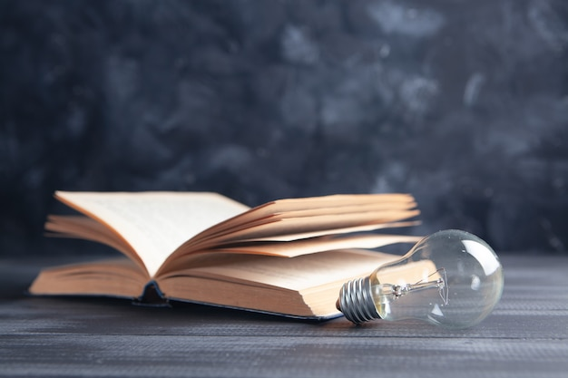 Light bulb and book on the table