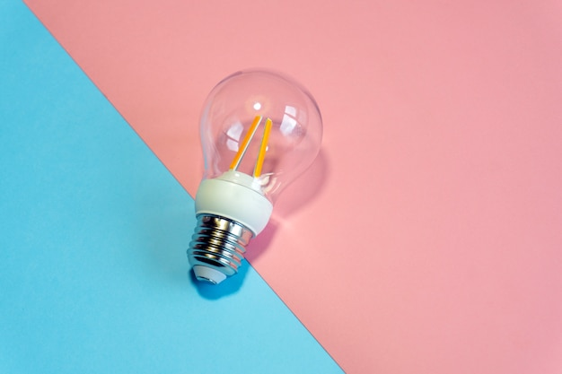 Light bulb on a colored background