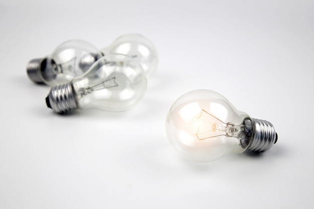 A light bulb or electric bulb with a bright orange color for creativity concept.