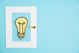 Light bulb frame with directional arrow on blue background