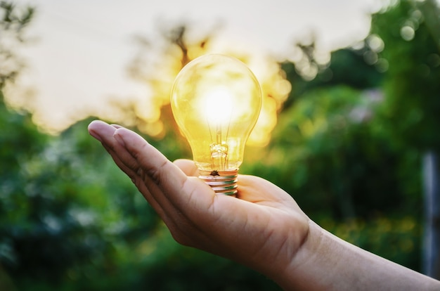 Light bulb from sunset on hand