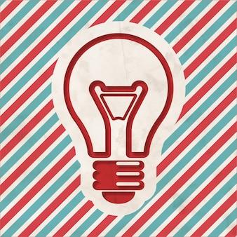 빨간색과 파란색 줄무늬 배경에 전구 아이콘. 평면 디자인의 빈티지 개념입니다.