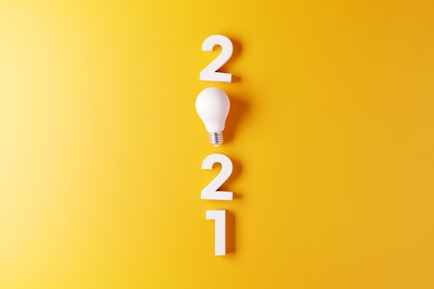 Light bulb idea with 2021 new year yellow background.