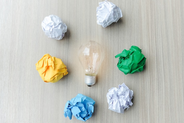 Light bulb or lamp with colorful crumpled paper